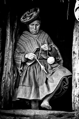Peruvian woman spinning wool on the go - Peru