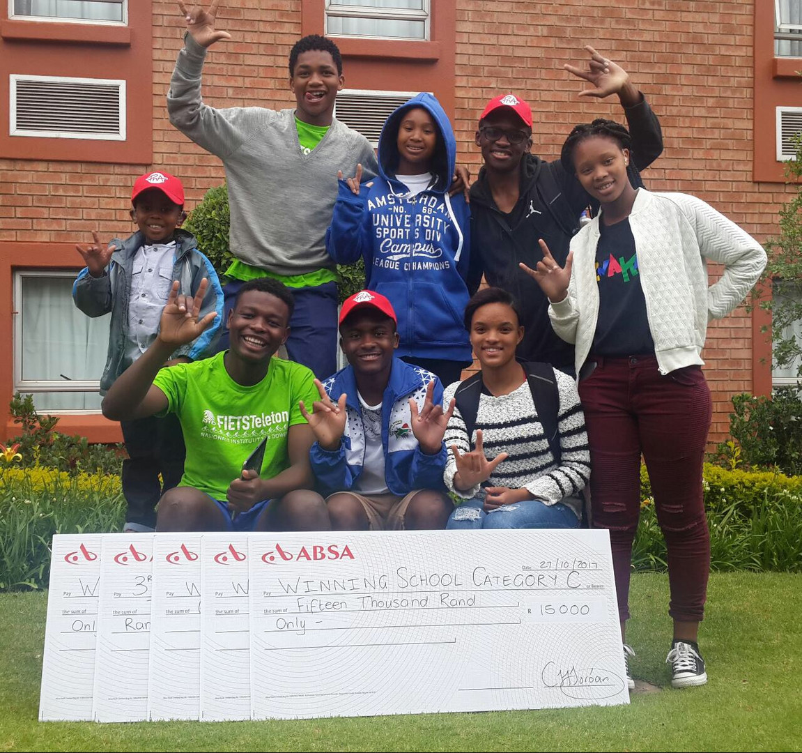 Bongani, Mbeketeli and their classmates celebrate their victories at Zwakala