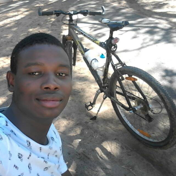Bongani with one of his favorite things: his bicycle