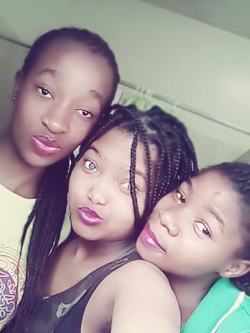 Siyanda, Siphesihle and Tandzile enjoying their time together at school