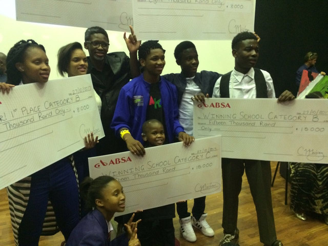 Mbeketeli, Bongani and their team posing with their first-place checks at the Zwakala drama competition