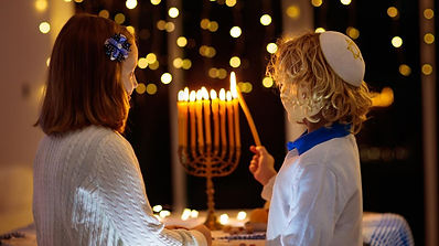 Hanukkah kids menorah lighting istock.jp