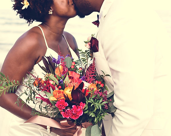 Couple kissing and holding bouquet.jpg