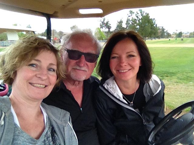 Dad & Jodi & myself playing golf in Arizona last February.