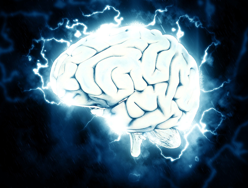 Picture of a brain with electricity coming out of it.