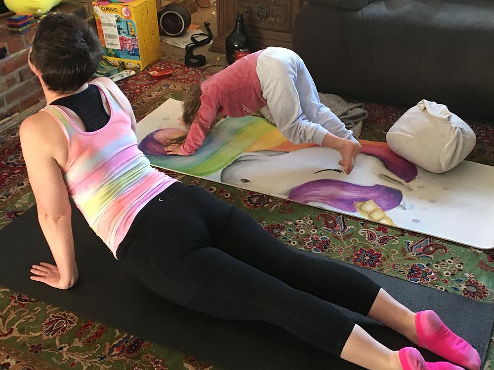 Mom and child doing yoga together.