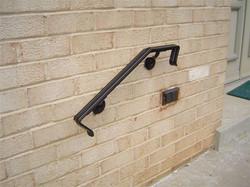 Wall rail w/ molded top bar