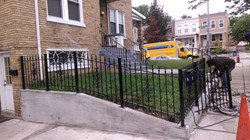 Fence with victorian panels & 3-winged sharp spears