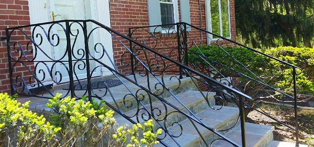 Scrolled porch & stair rail