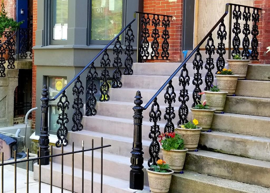 Decorative cast iron rails