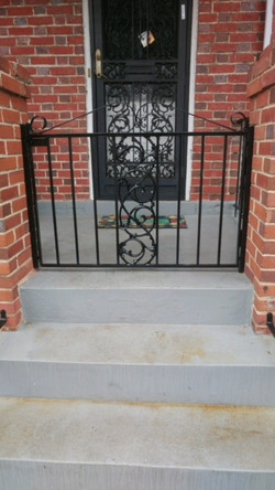 Front porch gate with decorative panel