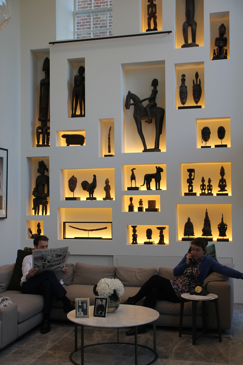 Incredible home decor with a wall full of small alcoves that fit african statues of all shapes and sizes
