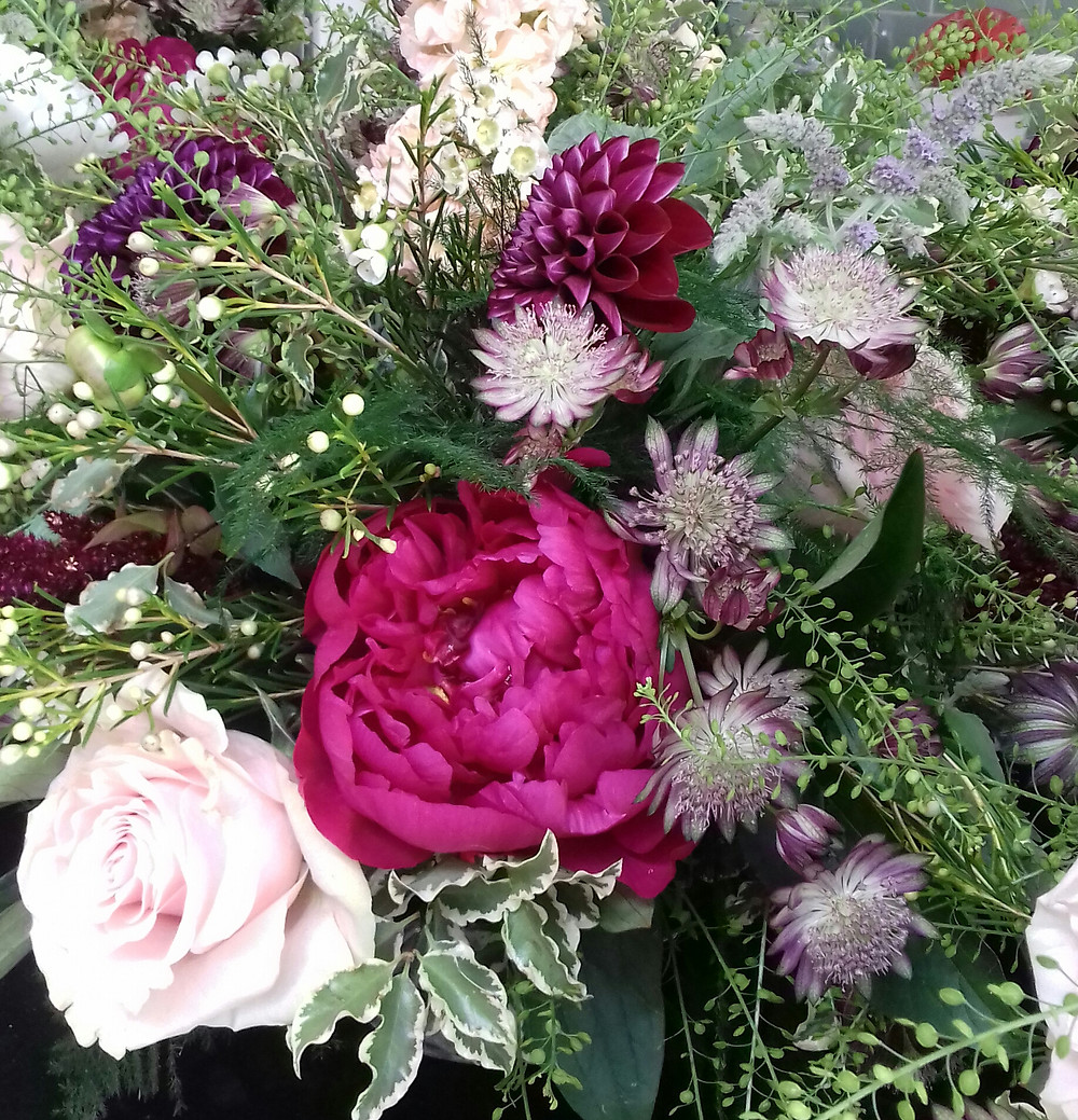 Bright pink and pastel pink flowers arranged beautifully for a wedding