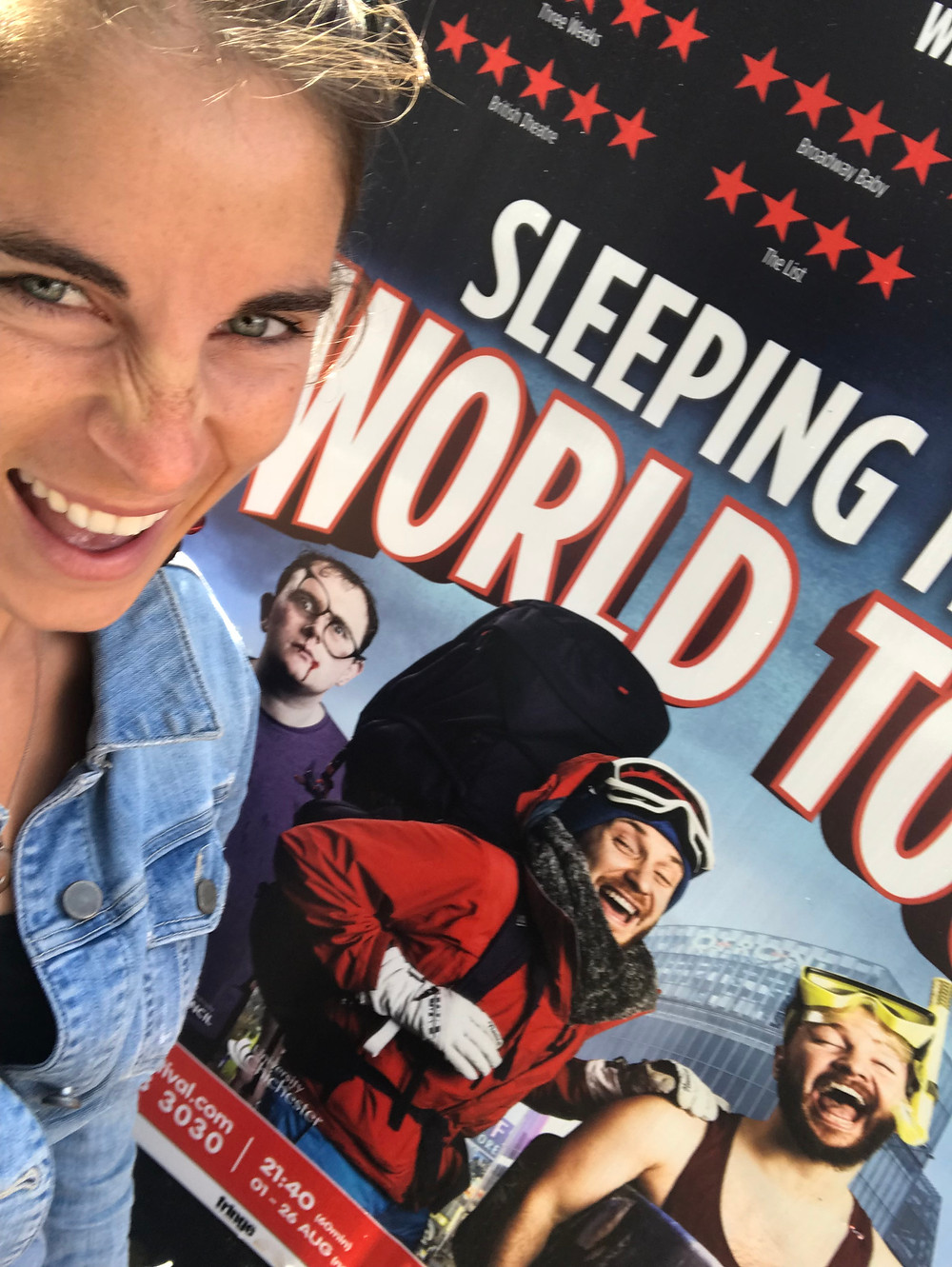 Girl stands in front of sleeping trees world tour poster smiling