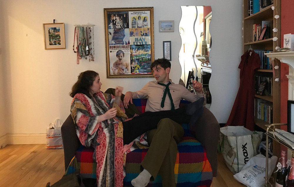 Actors rehearsing in a domestic living room