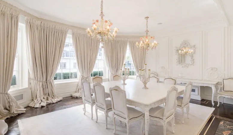 Stunning white room in palacial airbnb in Mayfair with white table and 10 chairs