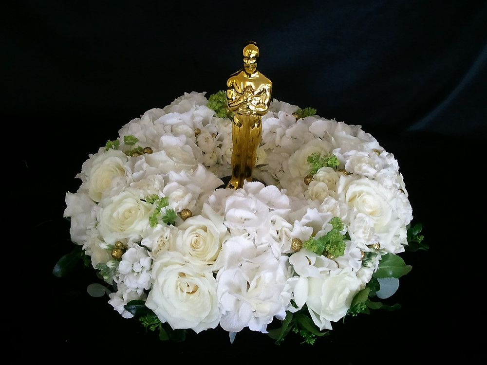Flowers for an oscars themed party with oscar statue in the middle