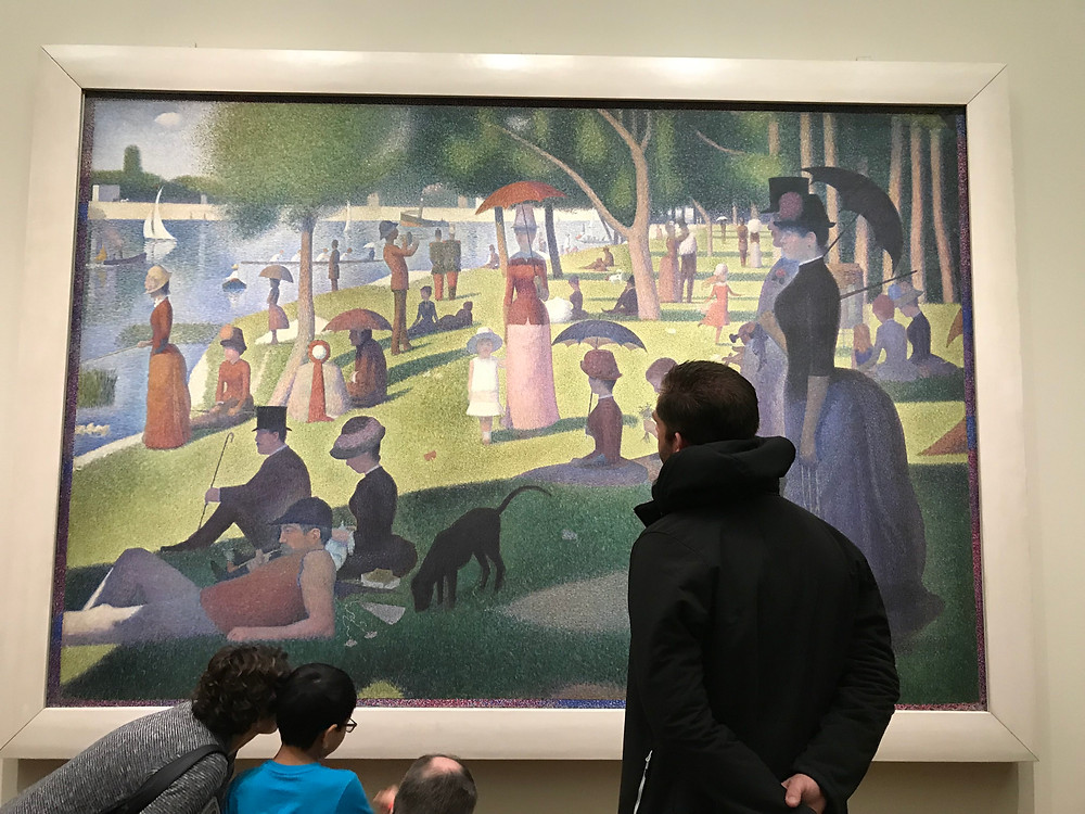 a sunday on la grande jatte in chicago art institute while a man and children look on