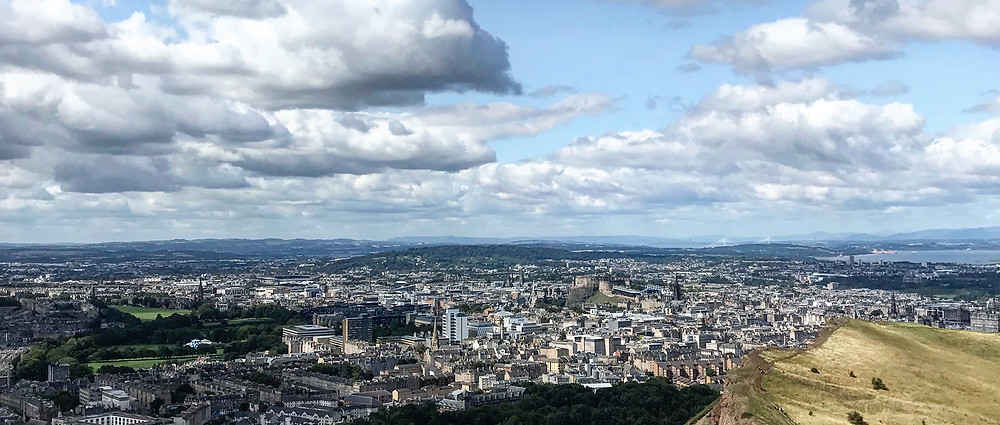 Beautiful view of Edinburgh from the top of Arthur's Seat on a cloudy by bright day
