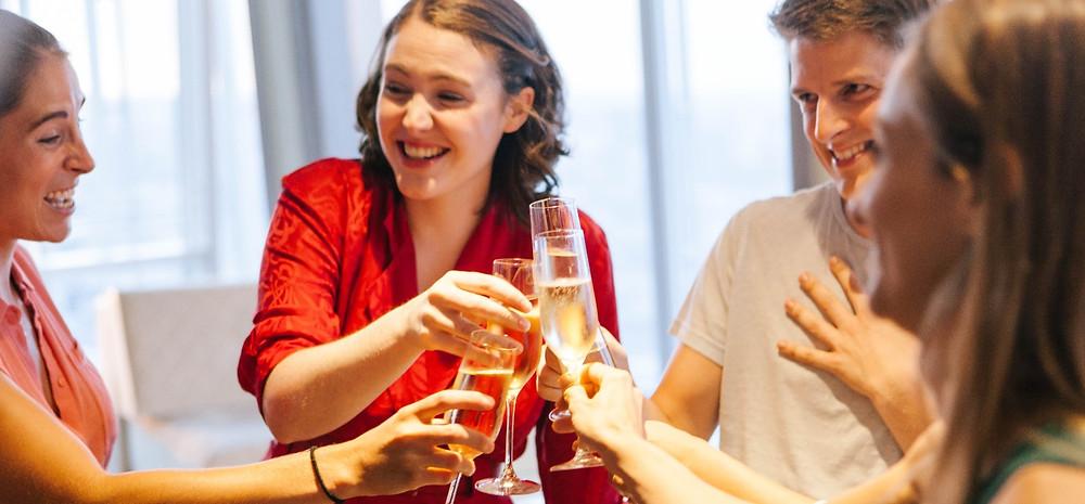 3 people cheers champagne melanie fullbrook lucy eaton freddie hutchins