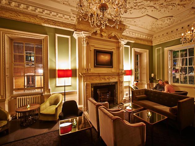 A green drawing room in regency style