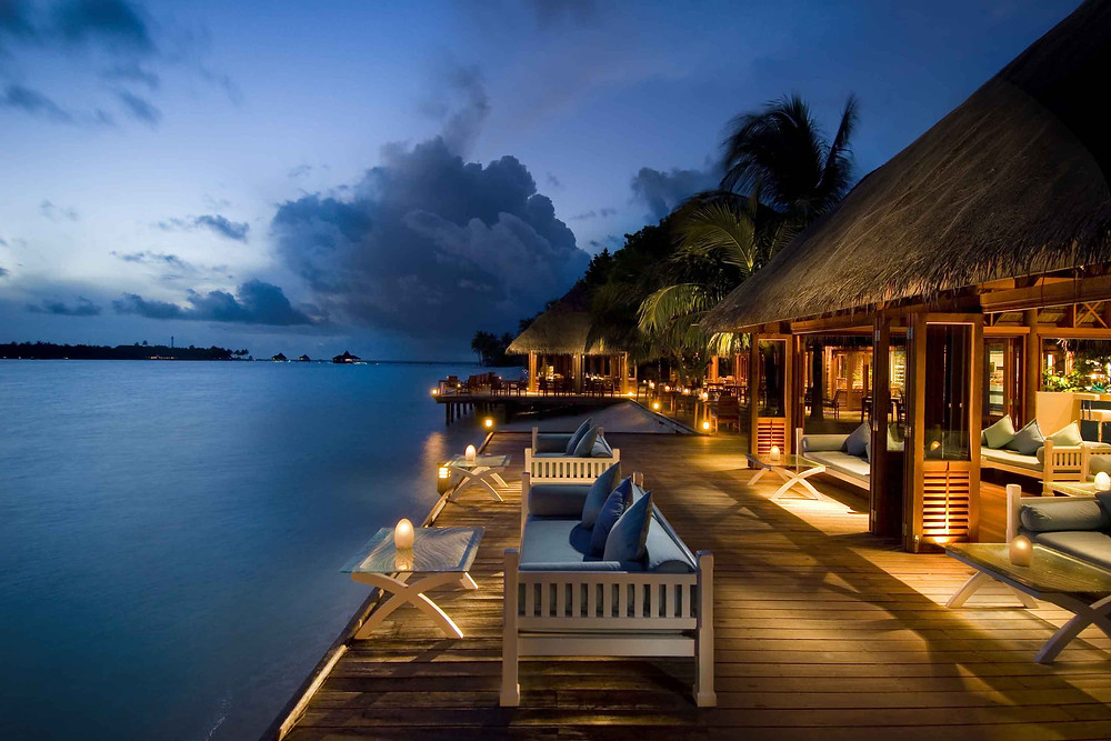 A maldives bar at the end of the ocean at dusk