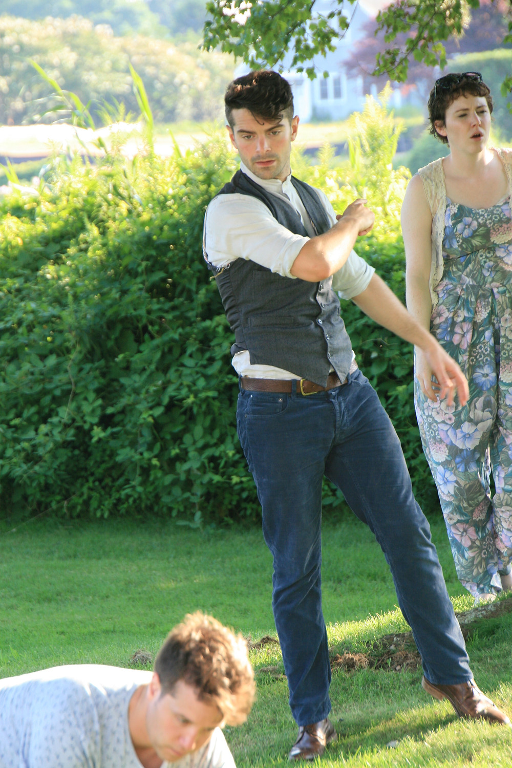Actor ludovic hughes rehearsing a midsummer night's dream in a garden for revels in hand
