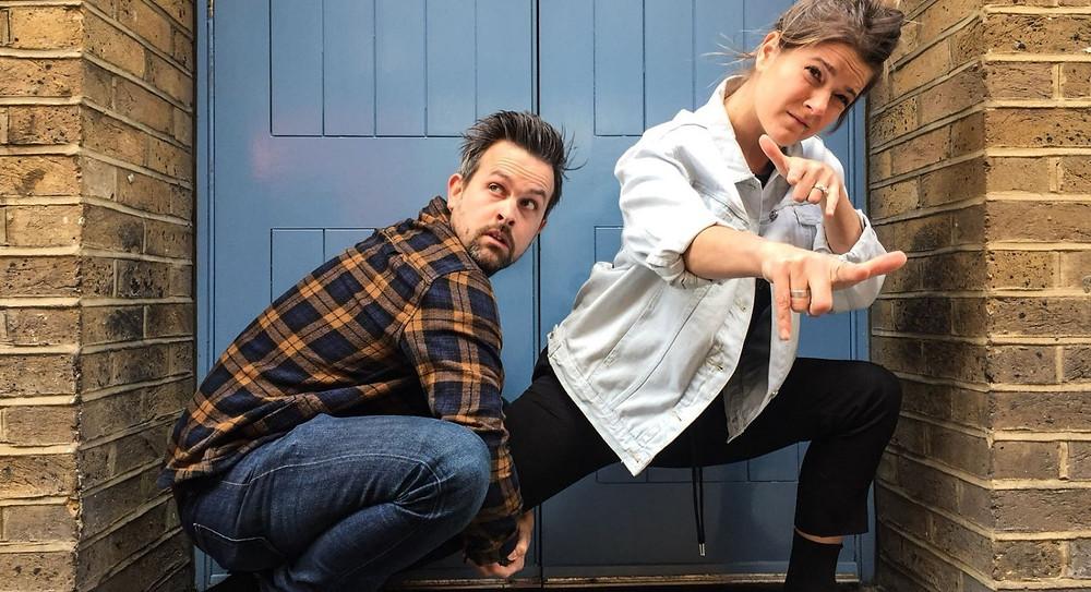 bread and geller comedians posing in blue doorway