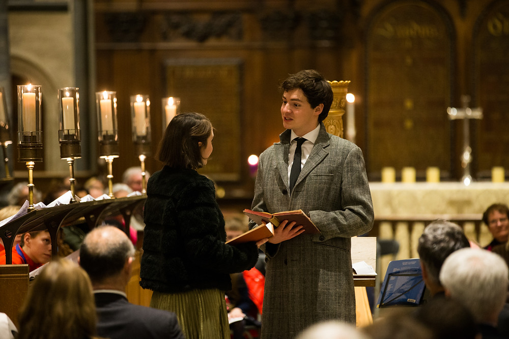 patrick walshe mcbride and melanie fullbrook perform a christmas carol in a candlelit church