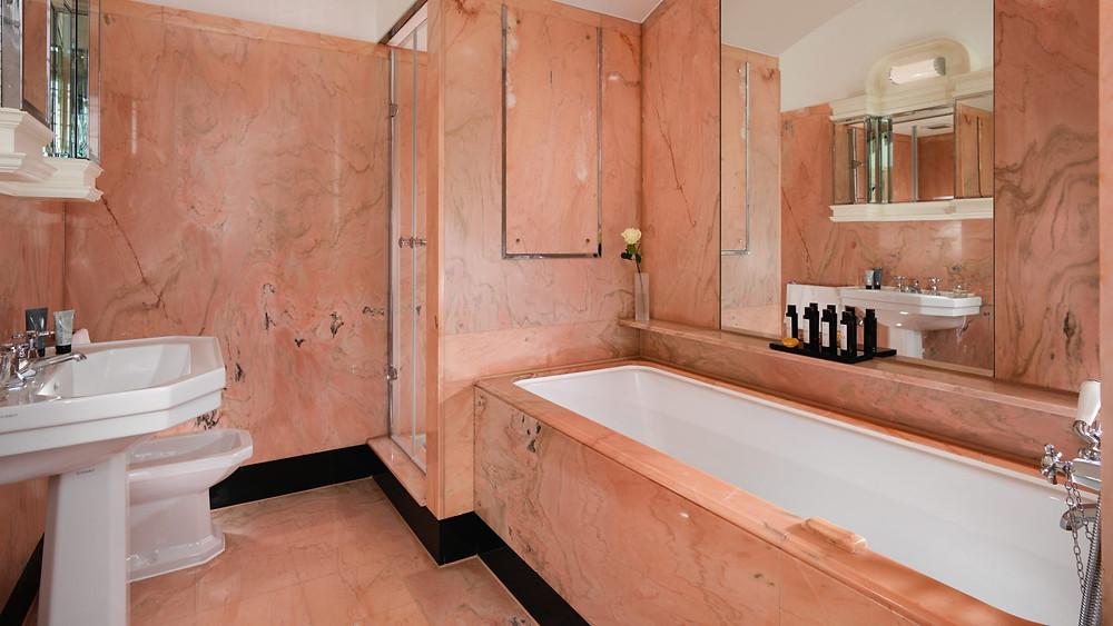 harlequin suite dorchester elizabeth taylor pink marble bathroom