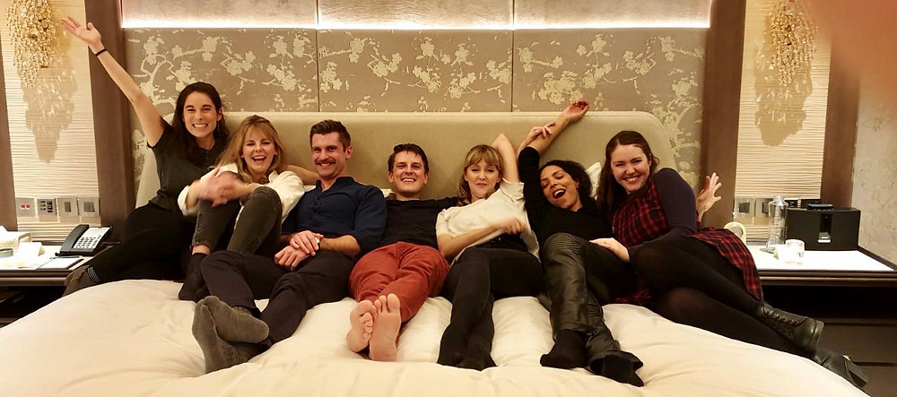 Actors for Revels in Hand relax on the enormous bed of the Shangri-La suite at the Shard