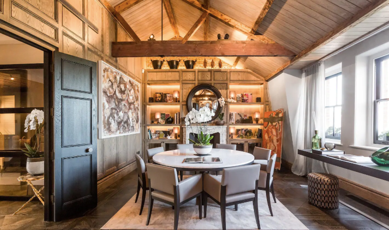 luxury living room of airbnb in Chelsea with wooden beams and rustic decor