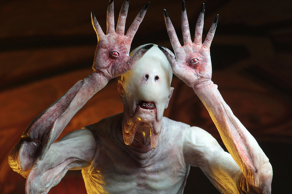 The pale man from pan's labyrinth with eyes in front of face