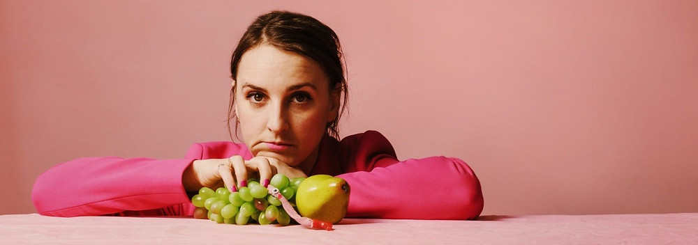 lucy pearman lady in pink with grapes and a pear