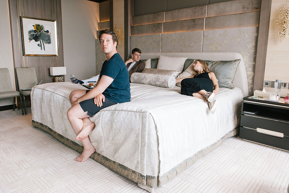 Revels in Hand actors lying on the bed in the shangri-la suite at the shangri-la hotel in the shard