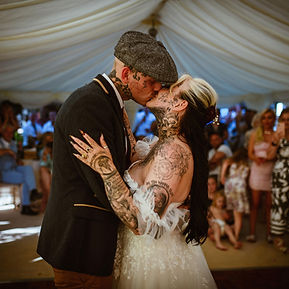 Tattooed couple handfasting ceremony