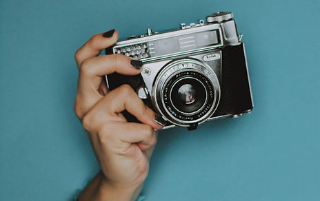 person-holding-black-slr-camera-2787216_