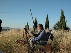 Gilou peignant en Toscane