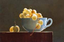 Tasse blanche aux raisins blancs