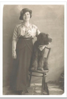 Standing Woman dog on chair.jpg