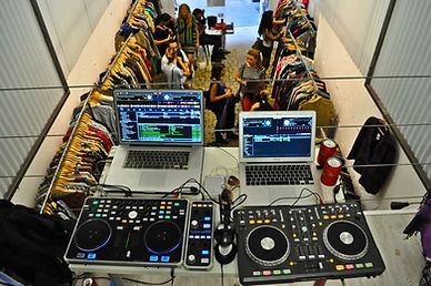 dj'ing in a clothing store with 2 laptops and 2 dj controllers