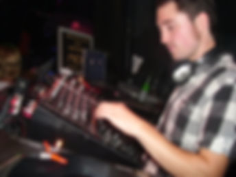 steely dave behind the decks dj'ing with serato in a nightclub