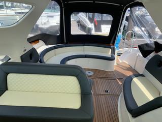 Cream and black diamond stitchyacht seating