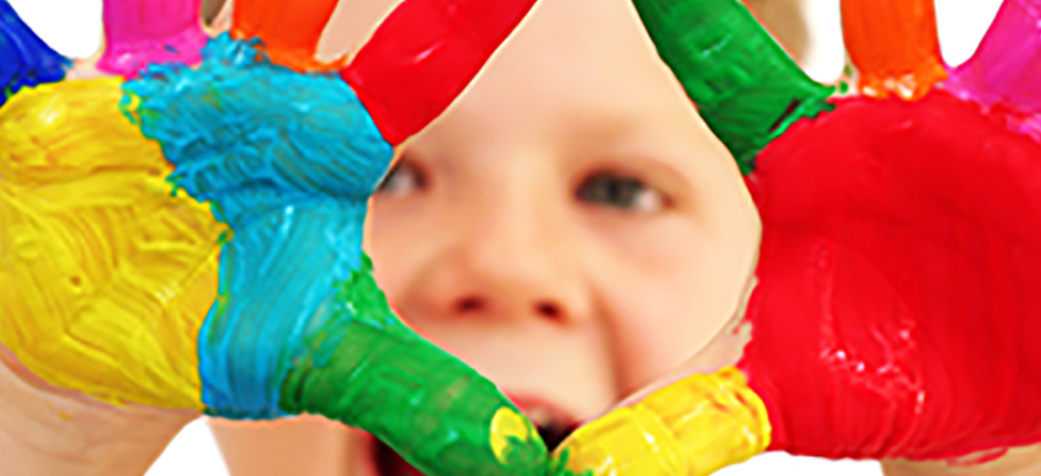 Bathing-Your-Child-Header-boy-with-colored-paint-on-hands-1440x430.png