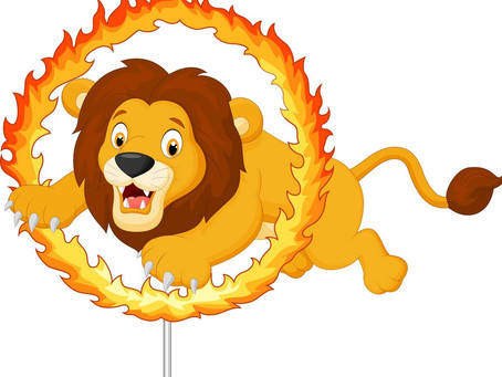 Lion jumping ........ a ring of fire in the circus | What will be an appropriate preposition ?