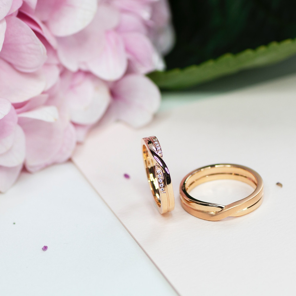 18K Rose Gold twirling with diamonds wedding bands
