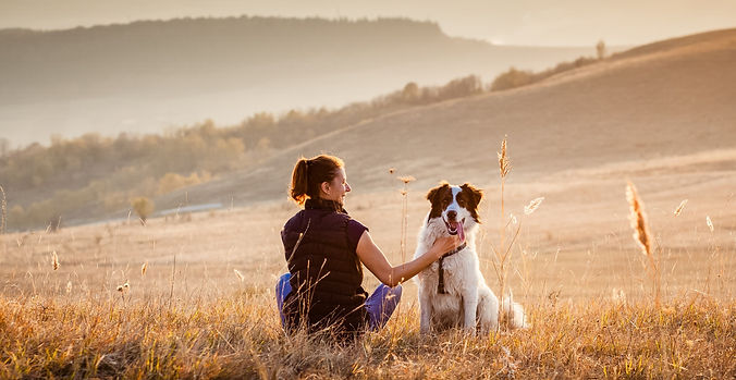 woman%20with%20dog%20relaxing%20in%20autumn%20landscape_edited.jpg