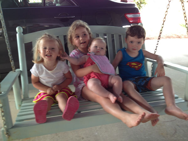 Grandkids on swing.JPG