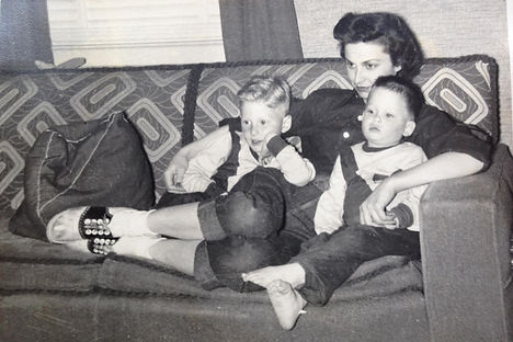 mom with boys on sofa cropped.jpg
