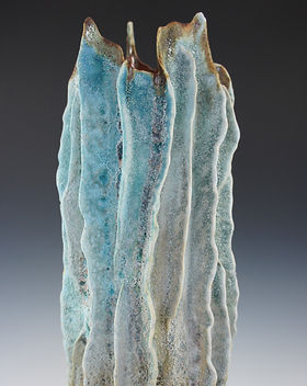 Ceramic art sculpture inspired by lava tube and created by Maui artist